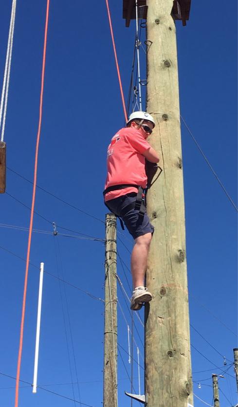 Guy climbing a pole