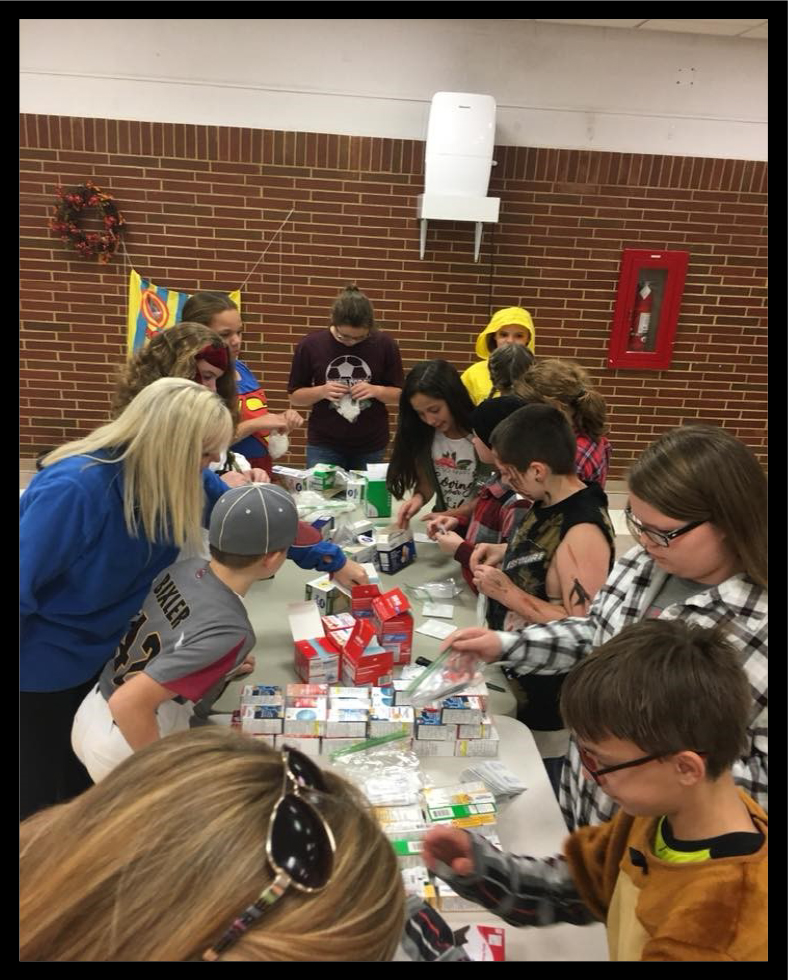 4-H MENTORING PROGRAM IN HARDIN COUNTY - 4-H'ers in a Harvest Party for mentees, mentees' families and mentors
