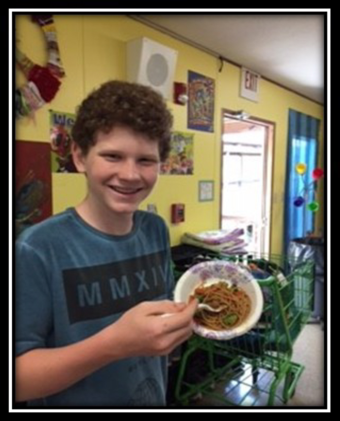 CUMBERLAND COUNTY FOOD, FUN, & FITNESS - 4-H'er enjoying spaghetti
