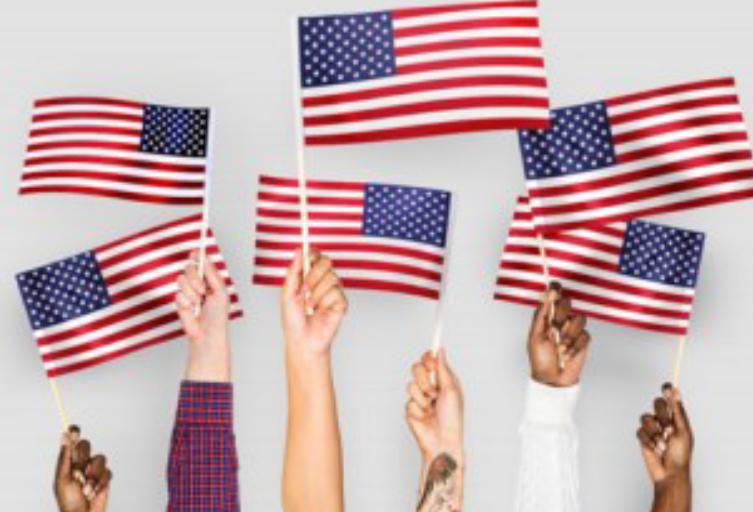 6 American Flags being held high
