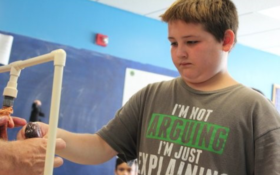 4-H Health Rocks! Produces Positive Results - 4-H'er working on his project