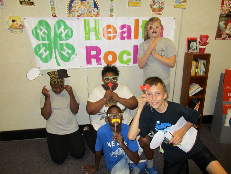 HENRY COUNTY GRADUATES YOUTH FOR HEALTHIER LIVES - 4-H kids making funny face masks from straws