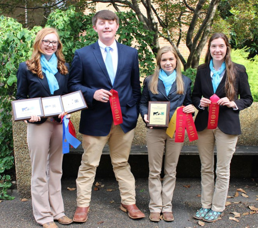 State 4-H Livestock Judging Competition - Lincoln County team consisting of Kendall Martin, Nathan Simmons, Olivia Hughes, and Juliann Fears