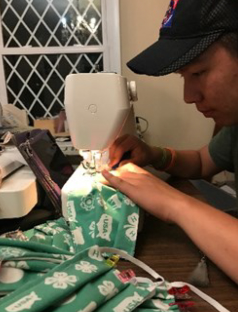 Madison County 4-H'er sewing COVID 19 masks